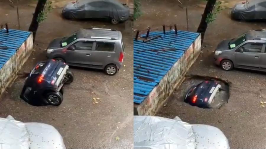 VIDEO Momentul în care o mașină este înghițită de o groapă, apărută din senin