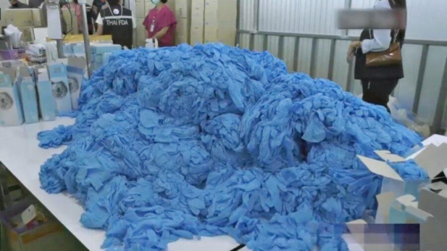 Zeci de milioane de mănuși medicale folosite au fost vândute ca noi în SUA, în plină pandemie, de o firmă din Thailanda