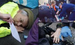 FOTO Gest disperat din partea unui protestatar! Și-a lipit fața de asfalt în centrul Londrei